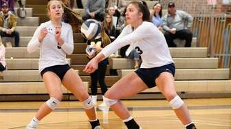 Gabriella Heimbauer of Massapequa digs during the Long