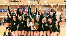The Seaford girls volleyball team with their winning