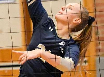 Andi Swedborg of Bayport-Blue Point knocks one over