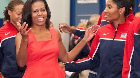 First Lady Michelle Obama meets members of the