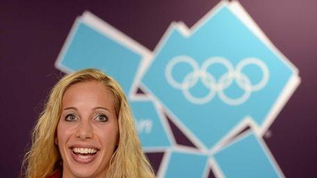 Fencer and United States flag bearer Mariel Zagunis