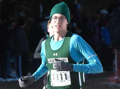 Gavin Ehlers of West Hampton Beach (1111) runs