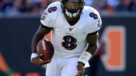 Lamar Jackson of the Baltimore Ravens runs with