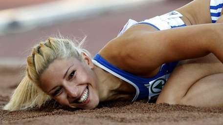 Greece's Voula Papachristou lands in the sand after