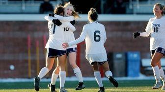 SWR #10 Ashley Borriello is embraced by teammates