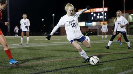 Ashley Borriello of Shoreham-Wading River clears the ball