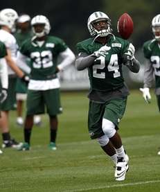 Darrelle Revis works out during the first day