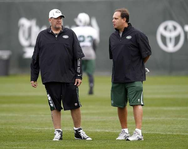 Head coach Rex Ryan talks with general manager
