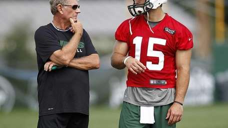 Tim Tebow talks with special teams coordinator Mike