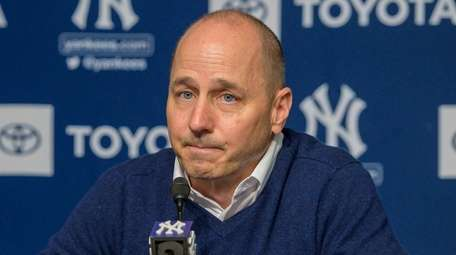 Yankees GM Brian Cashman speaking at an afternoon