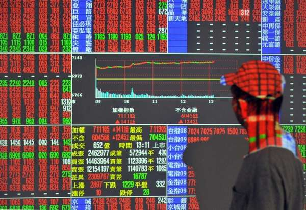 An investor monitors the stock market at a