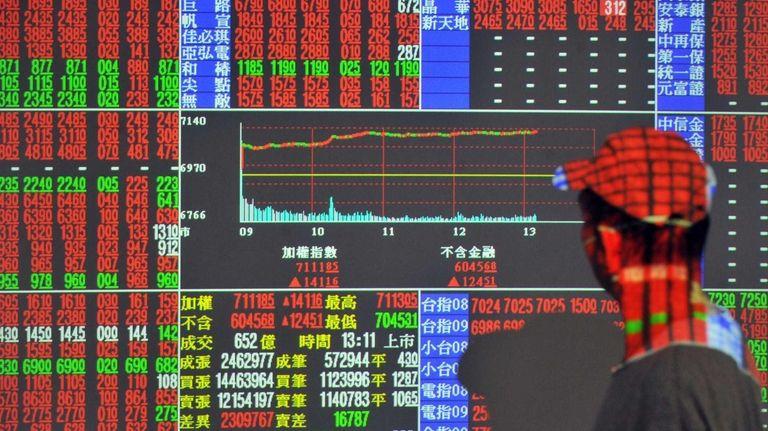 An investor monitors the stock market at a