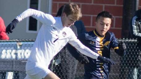 Rye's Michael Trayner, left and Jericho's Marcos Yang,