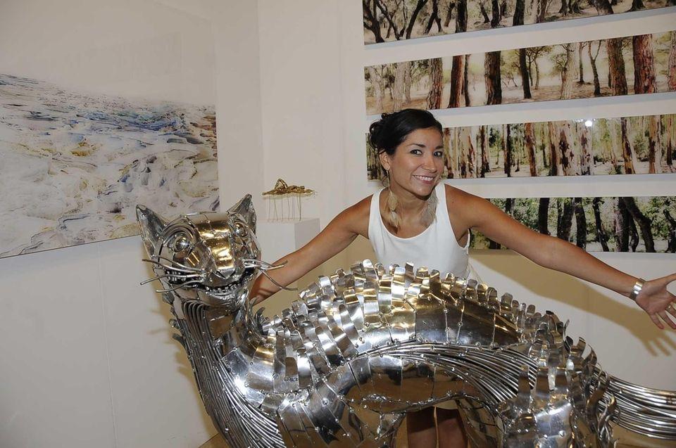 (l-r) Angela Fabregas shows a peice of art