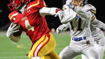 Chaminade's Donovan Wood gets away from Eamonn Flynn