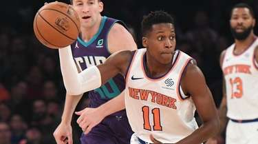 Knicks guard Frank Ntilikina looks to pass the