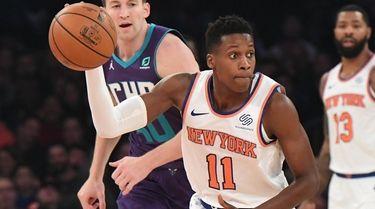 Knicks guard Frank Ntilikina looks to pass the