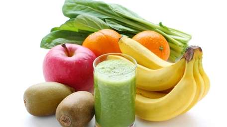 A green smoothie, with helpings of fruits and