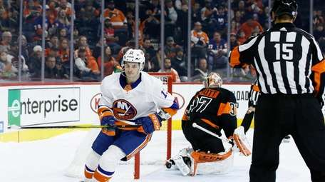 New York Islanders' Mathew Barzal (13) skates by