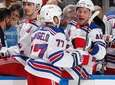 Teammates congratulate Tony DeAngelo of the Rangers after