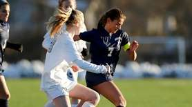 Massapequa #7 Jaclyn Portogallo controls the ball during