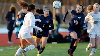 Massapequa #1 Lia Howard chases down the ball