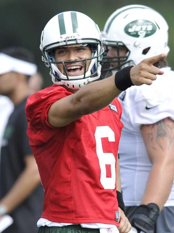 Jets quarterback Mark Sanchez reacts during practice on