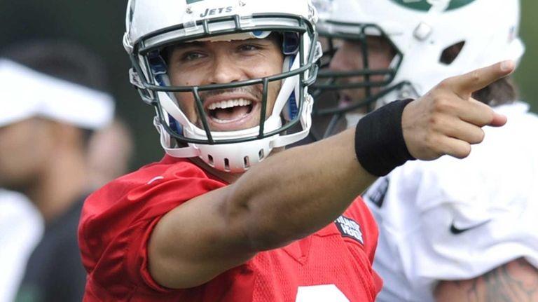 Jets quarterback Mark Sanchez reacts during practice on