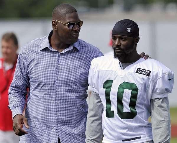 Former New York Jets receiver Keyshawn Johnson, left,