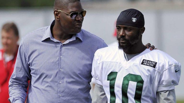 Former New York Jets receiver Keyshawn Johnson, left,