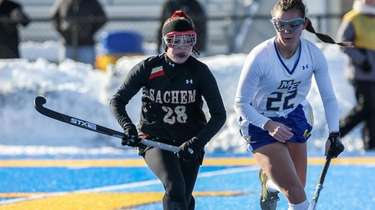 Sachem East's Alexandra Howell hustles for the ball