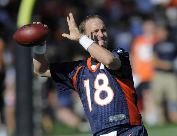 Denver Broncos quarterback Peyton Manning throws during the
