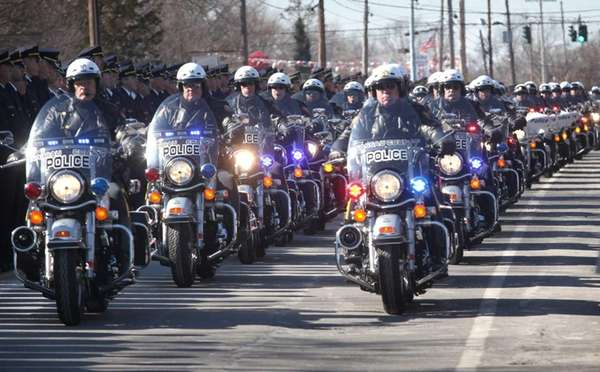Motorcycles from various departments lead the funeral persession