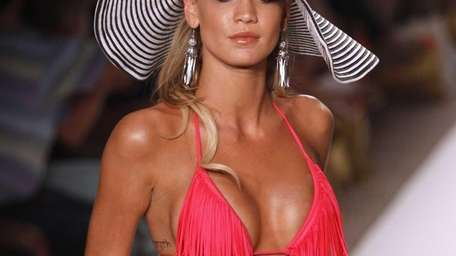 A model wears swimwear from the collection of