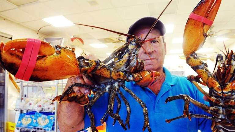 Lobsterman Roger Frate Sr. and two lobsters from
