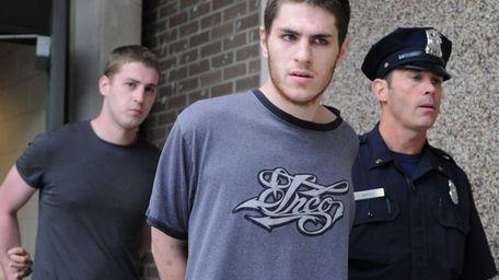 Anthony Deprospo, 22, of Bellport, is led out