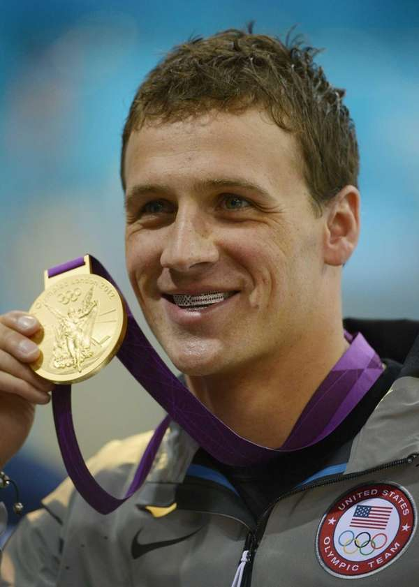 United States' Ryan Lochte poses with his gold