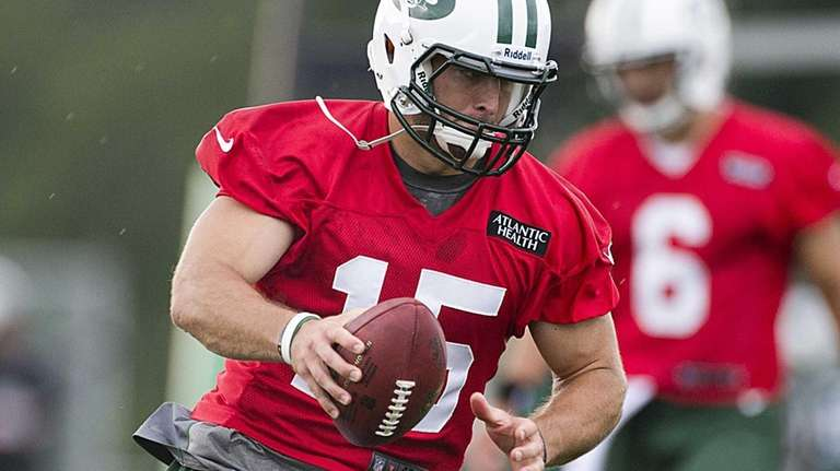 Jets quarterback Tim Tebow works on passing plays