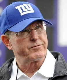 Giants head coach Tom Coughlin watches his team