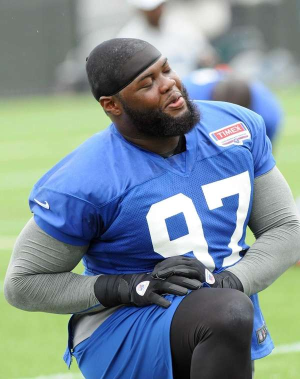 Linval Joseph stretches during training camp. (July 28,