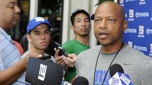 Giants GM Jerry Reese talks with reporters during