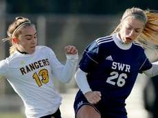 Spencerport #13 Sabrina Trapani and SWR #26 Lydia