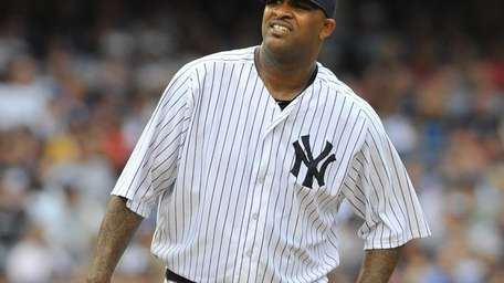 CC Sabathia watches the flight of a ball