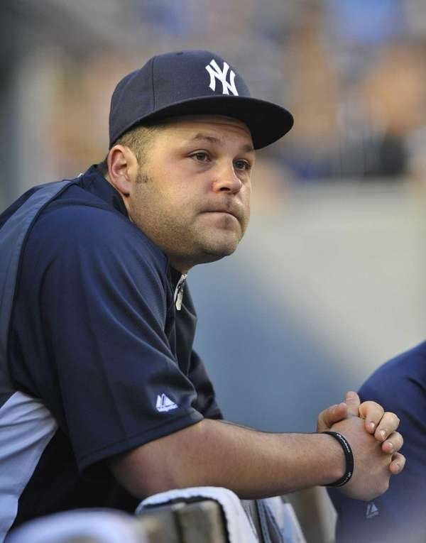 Joba Chamberlain watches the Yankees play the