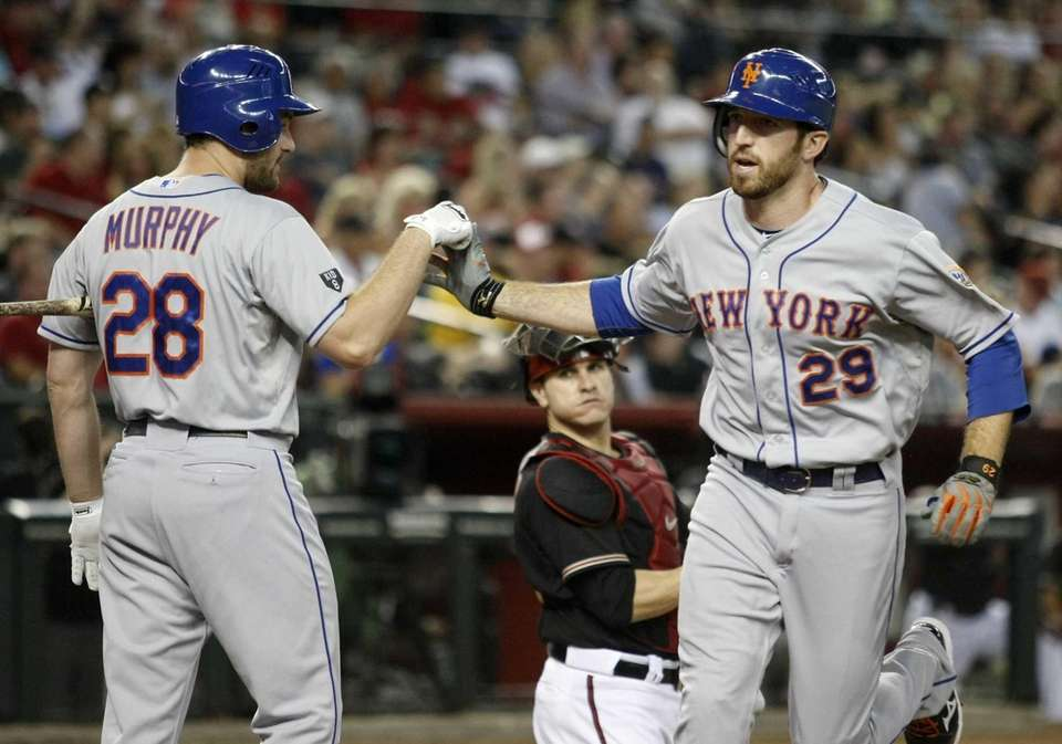 New York Mets' Ike Davis, right, celebrates with