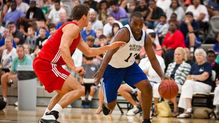 Arthur Robertson drives to the basket in front