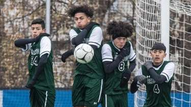 Brentwood players block the goal during the NYSPHSAA
