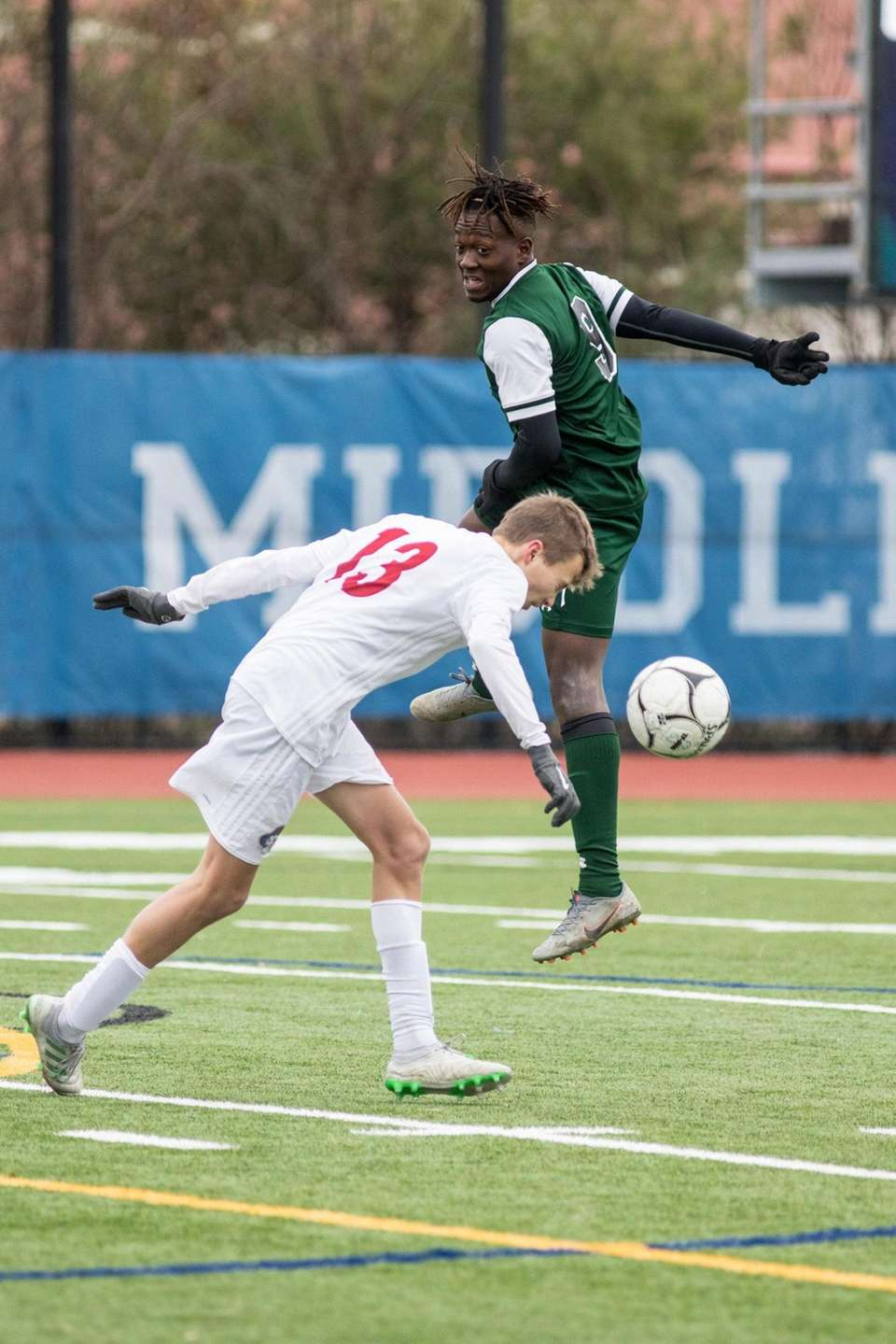 Fairport's Aidan Fish, left and Brentwood's Nathaniel Austin,