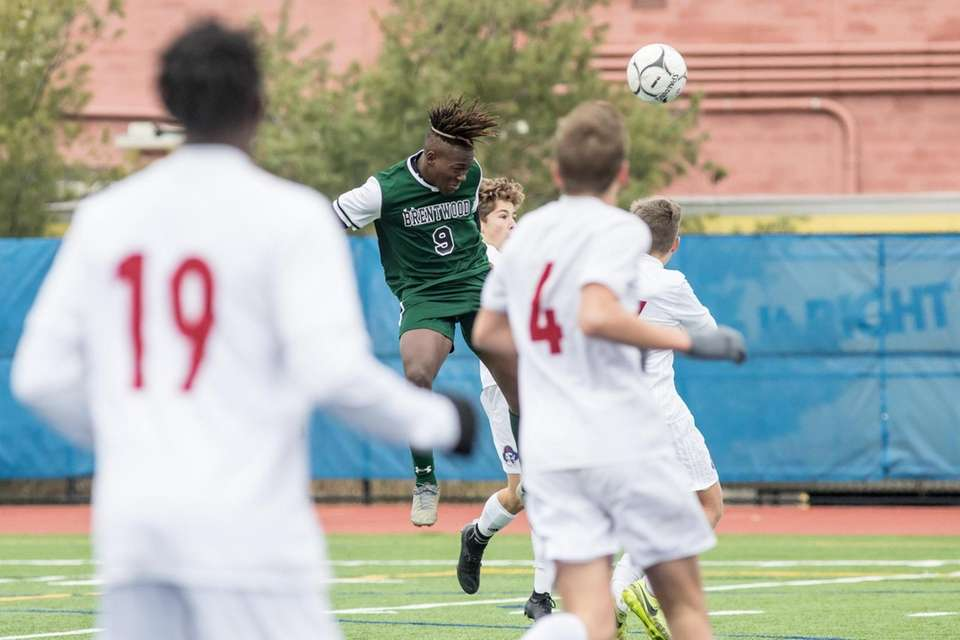 Brentwood's Nathaniel Austin heads the ball during the