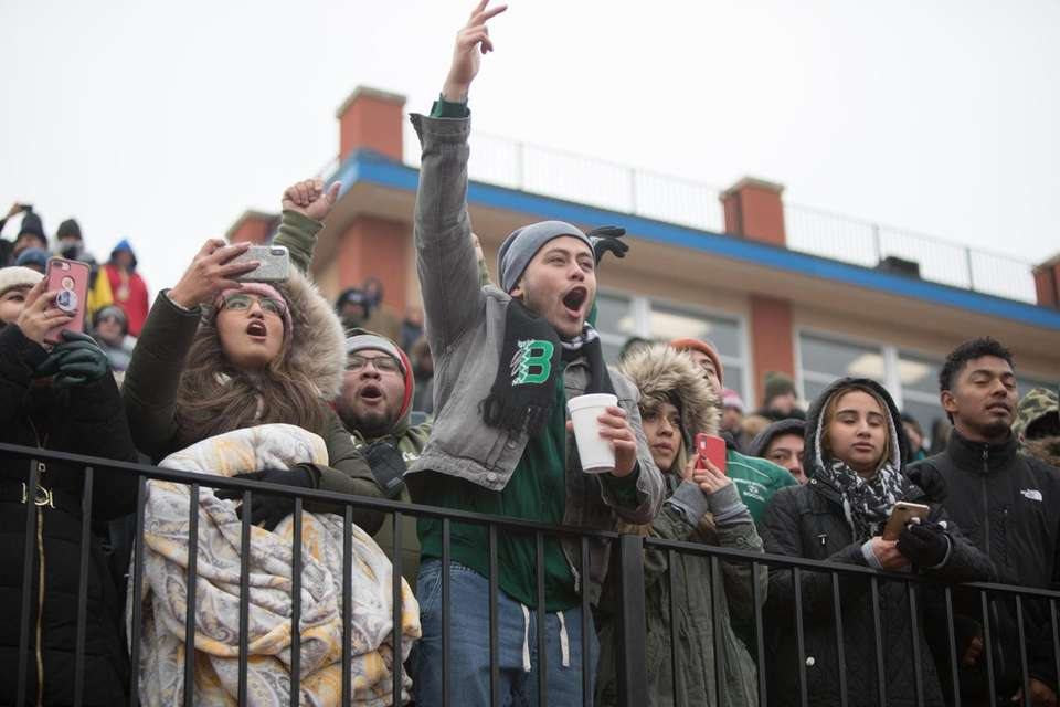 Brentwood fans cheer for their team during the